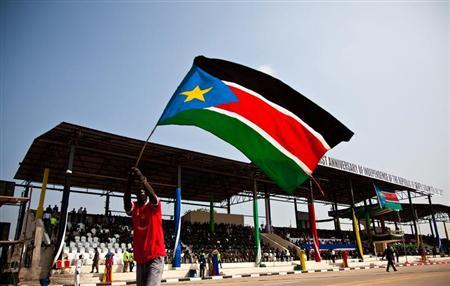A man waves the national flag of South Sudan during celebrations to mark the country's first anniversary of its independence in Juba, July 9, 2012. REUTERS/Adriane Ohanesian