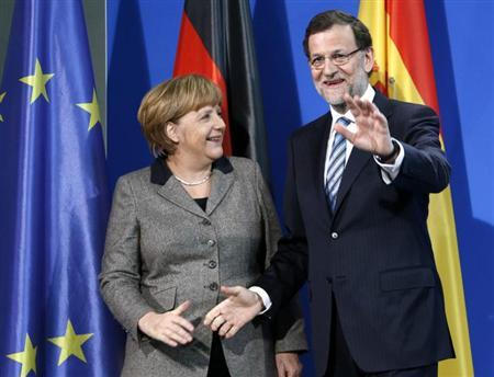 German Chancellor Angela Merkel and Spanish Prime Minister Mariano Rajoy leave a news conference at the Chancellery in Berlin February 4, 2013. REUTERS/Fabrizio Bensch (GERMANY - Tags: POLITICS)