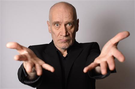 Musician Wilko Johnson poses for a photograph at his home in Westcliff - on- sea, Essex, southern England February 1, 2013. Johnson, cult guitarist from 1970s beat band Dr Feelgood and herald of English punk rock, is on a high - even though he is dying of pancreatic cancer. The musician, songwriter and sometime actor has watched with amazement as a planned tour of farewell concerts sold out and interest has surged in almost anything he has touched, including the 2009 award-winning documentary ''Oil City Confidential.'' Photograph taken on February 1, 2013. REUTERS/Paul Hackett
