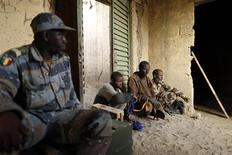 Islamist rebel prisoners guarded by Malian gendarmes are seen in a military camp in the centre of Timbuktu February 1, 2013. REUTERS/Benoit Tessier (MALI - Tags: POLITICS CIVIL UNREST CONFLICT)