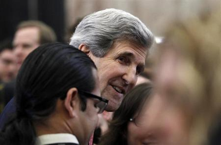 John Kerry, the new U.S. Secretary of State, greets employees of the State Department in Washington February 4, 2013. Today is Kerry's first official day at the State Department. REUTERS/Gary Cameron
