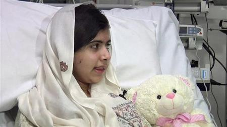 Pakistani schoolgirl, Malala Yousufzai, who was shot in the head by the Taliban for advocating girls' education, is seen sitting in her hospital bed in this undated still picture taken from video provided by the Queen Elizabeth Hospital, in Birmingham, central England, and received in London on February 4, 2013. Yousufzai has undergone successful surgery to reconstruct her skull and help restore lost hearing. REUTERS/Queen Elizabeth Hospital/Handou