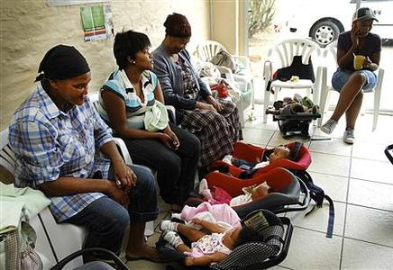 Mothers and their infants await appointments with health researchers as part of a clinical trial to develop new TB vaccines at the South African Tuberculosis Vaccine Initiative's clinical trial field site in Worcester, South Africa in this April 2012 handout photo obtained by Reuters February 1, 2013. Global health experts are eagerly awaiting clinical trial results - expected early next week - of MVA85A, the first new vaccine in 90 years designed to prevent tuberculosis infections. REUTERS/Aeras/Handout