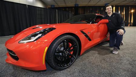 Baltimore Ravens Quarterback Joe Flacco is presented with a 2014 Chevrolet Corvette Stingray for being named Super Bowl XLVII MVP in New Orleans, Louisiana, February 4, 2013. REUTERS/AJ Mast/Chevrolet/Handout