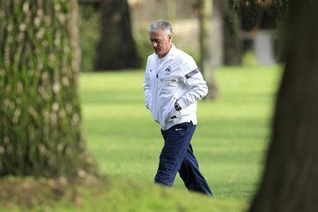 France's national soccer team coach Didier Deschamps arrives to attend a news conference at Clairefontaine, near Paris, February 4, 2013. REUTERS/Gonzalo Fuentes