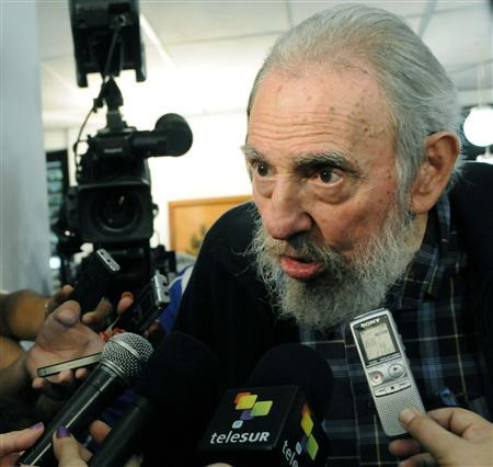 Former Cuban leader Fidel Castro speaks to reporters at a polling station in Havana February 3, 2013. REUTERS/AIN FOTO/Marcelino Vazquez