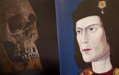 A television image of King Richard III's skull is seen next to a portrait of him during a news conference in Leicester, central England February 4, 2013. REUTERS/Darren Staples