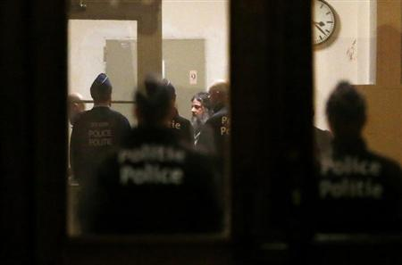 Belgian child murderer Marc Dutroux (C), whose crimes horrified Belgium in the 1990s, is escorted by police officers at the Palace of Justice in Brussels February 4, 2013. REUTERS/Francois Lenoir