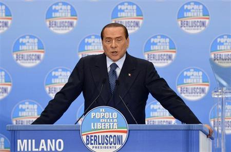 Italy's former prime minister Silvio Berlusconi speaks during a political rally in Milan February 3, 2013. REUTERS/Paolo Bona