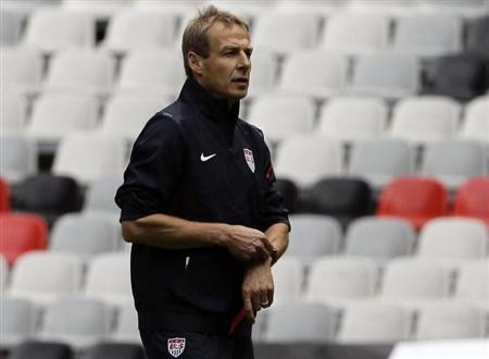 Head coach of the U.S. national soccer team Jurgen Klinsmann of Germany looks at his players during a practice session at the Azteca stadium in Mexico City August 14, 2012. REUTERS/Henry Romero