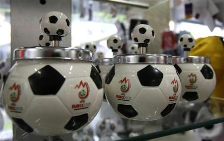 Ash trays in soccer design are pictured in a souvenir shop in Vienna May 6, 2008. REUTERS/Leonhard Foeger/Files