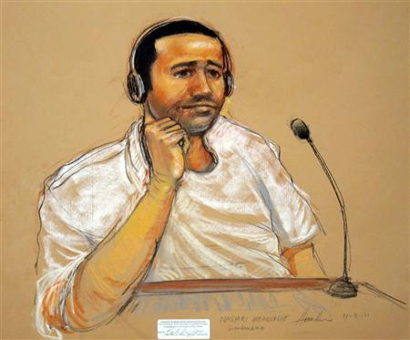 In this sketch approved by the military by court artist Janet Hamlin, and obtained by Reuters on November 9, 2011, Abd Al Rahim Hussayn Muhammad al-Nashiri watches courtroom proceedings. Pretrial hearings for al-Nashiri, accused of orchestrating a deadly attack on a U.S. warship, were brought to a temporary standstill on Monday as defense lawyers raised concerns that intelligence agents were eavesdropping on confidential attorney-client conversations. REUTERS/Janet Hamlin/Handout/Files
