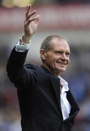 Ex-Rangers' player Paul Gascoigne reacts to the supporters' reception for him at half time during their Scottish Premier League soccer match against St Mirren at Ibrox Stadium, Glasgow, Scotland October 15, 2011. REUTERS/Russell Cheyne