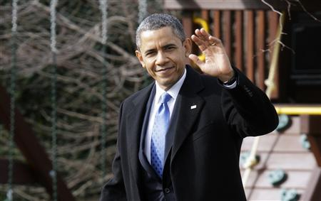 President Barack Obama waves to reporters as he walks across the South Lawn to board the Marine One helicopter for departure to Minnesota, where he will deliver remarks on reducing gun violence, from the White House in Washington, February 4, 2013. REUTERS/Jonathan Ernst