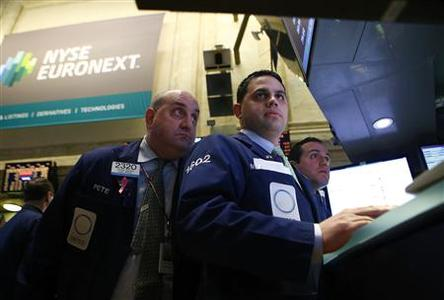 Traders work on the floor of the New York Stock Exchange February 4, 2013. REUTERS/Eric Thayer