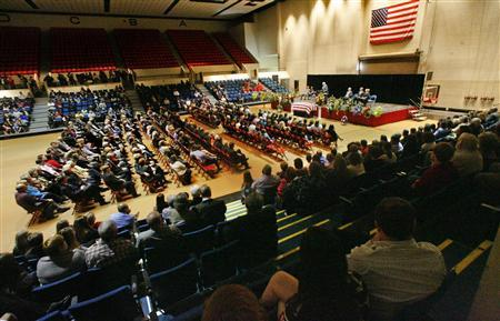 Hundreds of people attend the funeral for bus driver Charles Albert Poland Jr. at Ozark Civic Center, near Midland City, Alabama, February 3, 2013. REUTERS/Phil Sears