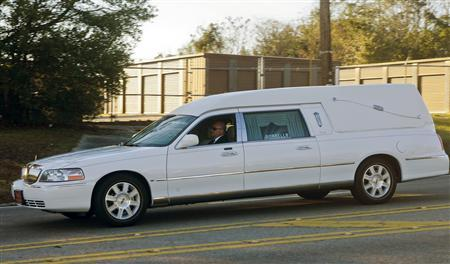 A hearse containing the body of bus driver Charles Albert Poland Jr. heads down South Union Ave. in Ozark to the burial site near Midland City, Alabama, February 3, 2013. REUTERS/Phil Sears (UNITED STATES - Tags: CRIME OBITUARY)