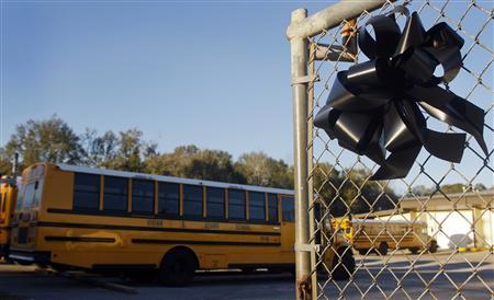 A black wreath in honor of murdered school bus driver Charles Poland is attached to a fence at the entrance to the Dale County Bus Barn on Highway 27 outside Ozark, Alabama, near Midland City, February 1, 2013. REUTERS/Philip Sears