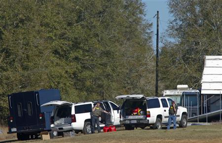 Law enforcement officials from the FBI work the scene of a shooting and hostage taking in Midland City, Alabama, January 31, 2013. A gunman suspected of fatally shooting an Alabama school bus driver before holing up in an underground bunker with a young child is a Vietnam veteran with anti-government views, authorities and an organization that tracks hate groups said. REUTERS/Phil Sears