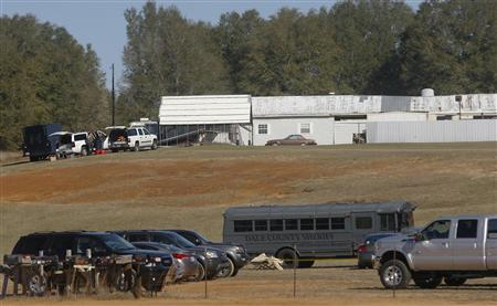 Law enforcement officials work the scene of a shooting and hostage taking in Midland City, Alabama, January 31, 2013. A gunman suspected of fatally shooting an Alabama school bus driver before holing up in an underground bunker with a young child is a Vietnam veteran with anti-government views, authorities and an organization that tracks hate groups said. REUTERS/Phil Sears