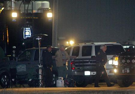 Law enforcement officials continue to man a command center in the evening near the scene of a shooting and hostage taking that happened five days ago near Midland City, Alabama February 3, 2013. REUTERS/Phil Sears