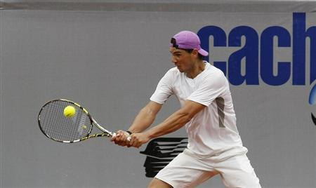 Spanish tennis player Rafael Nadal hits a return during a training session at country club Las Salinas in Vina del Mar City, about 121 km (75 miles) northwest of Santiago February 4, 2013. REUTERS/Eliseo Fernandez