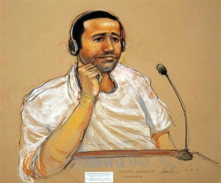 In this sketch approved by the military by court artist Janet Hamlin, and obtained by Reuters on November 9, 2011, Abd Al Rahim Hussayn Muhammad al-Nashiri watches courtroom proceedings. REUTERS/Janet Hamlin/Handout