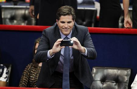 Tagg Romney, son of Republican presidential nominee Mitt Romney, takes a picture from the VIP box during the second session of the Republican National Convention in Tampa, Florida August 28, 2012. REUTERS/Joe Skipper