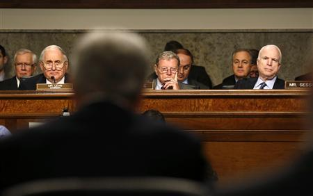 U.S. Senators Carl Levin (D-MI), James Inhofe (R-OK) and John McCain (R-AZ) (L-R) listen as former Senator Chuck Hagel (foreground) testifies during a Senate Armed Services Committee hearing on Hagel's nomination to be Defense Secretary, on Capitol Hill in Washington, January 31, 2013. REUTERS/Larry Downing