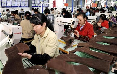 Employees work at a shoe factory in Dongkou county, Hunan province April 5, 2012. REUTERS/China Daily/Files