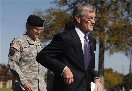 Secretary of the Army John M. McHugh (R) and Army Chief of Staff General George Casey (L) make their way to the podium to address the media at the Fort Hood Army Post in Fort Hood, Texas November 6, 2009. REUTERS/Jessica Rinaldi