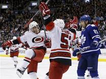 Carolina Hurricanes' Patrick Dwyer (L) celebrates his goal with teammate Jeff Skinner (C) in front of Toronto Maple Leafs' James van Riemsdyk during the third period of their NHL hockey game in Toronto February 4, 2013. REUTERS/Mark Blinch