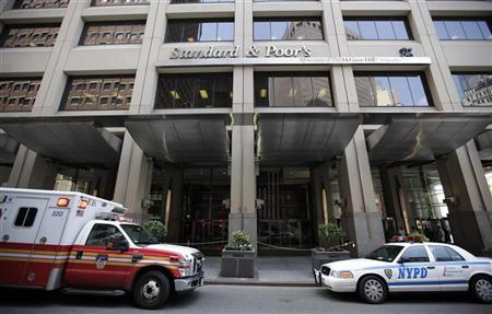 A New York City Fire Department ambulance and a New York Police car are seen parked in front of The Standard and Poor's building in New York August 8, 2011. REUTERS/Brendan McDermid/Files