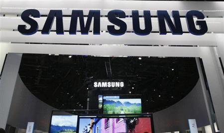 New televisions are displayed at the Samsung booth on the first day of the Consumer Electronics Show (CES) in Las Vegas January 8, 2013. REUTERS/Rick Wilking/Files