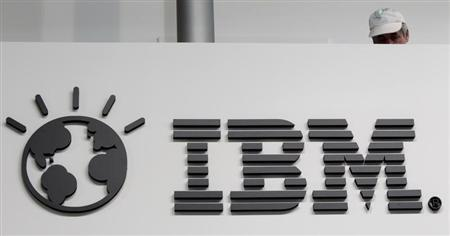 A worker is pictured behind a logo at the IBM stand on the CeBIT computer fair in Hanover February 26, 2011. The world's largest IT fair CeBIT opens its doors on March 1 and runs through March 5. REUTERS/Tobias Schwarz