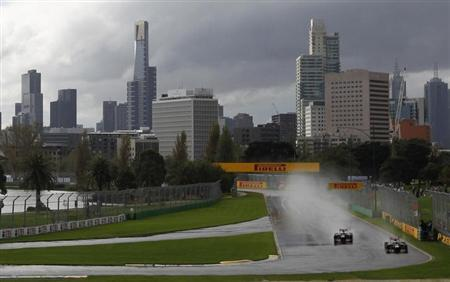 Toro Rosso Formula One driver Jean-Eric Vergne (L) of France and his team mate Daniel Ricciardo of Australia drive during a practice session of the Australian F1 Grand Prix at the Albert Park circuit in Melbourne March 16, 2012. REUTERS/Daniel Munoz/Files