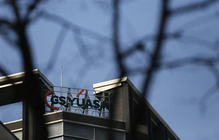 A logo of GS Yuasa Corp. is seen atop the company's Tokyo office January 9, 2013. REUTERS/Issei Kato/Files