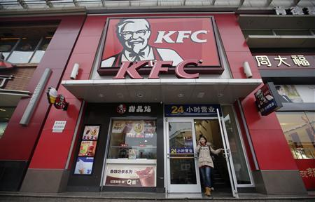 A woman walks out from a KFC restaurant as she speaks on her mobile phone in Wuhan, Hubei province, February 5, 2013. KFC parent Yum Brands Inc warned on Monday that it expects 2013 earnings to shrink rather than grow as it struggles to manage a food safety scare in China, and sees no return to growth in restaurant sales there until the fourth quarter. REUTERS/Stringer