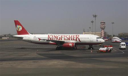 A Kingfisher Airlines aeroplane sits on the tarmac at Chhatrapathi Shivaji International Airport in Mumbai, March 9, 2012. REUTERS/Vivek Prakash