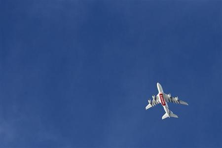An A380 Emirates Airlines plane flies over Paris, November 21, 2012. REUTERS/Benoit Tessier