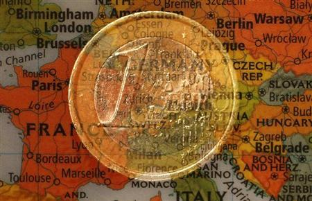A picture illustration taken with the multiple exposure function of the camera shows a one Euro coin and a map of Europe, January 9, 2013. REUTERS/Kai Pfaffenbach/Files