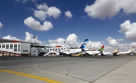 Aircraft are seen parked on the tarmac at Tripoli airport September 16, 2012. REUTERS/Anis Mili