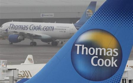 Thomas Cook aircraft are seen parked on the tarmac at Manchester airport in Manchester, northern England, November 22, 2011. REUTERS/Phil Noble