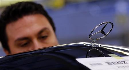 A worker assembles a Mercedes-Benz C-class model at their plant in Sindelfingen near Stuttgart February 5, 2013. Daimler AG with its Mercedes-Benz car group, will hold their annual new conference on Friday. REUTERS/Michael Dalder
