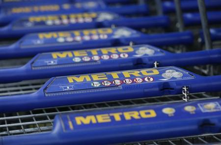 Shopping carts of Germany's biggest retailer Metro AG are lined up at a Metro cash and carry market in the western German city of Sankt Augustin near Bonn May 23, 2012. (GERMANY - Tags: BUSINESS)