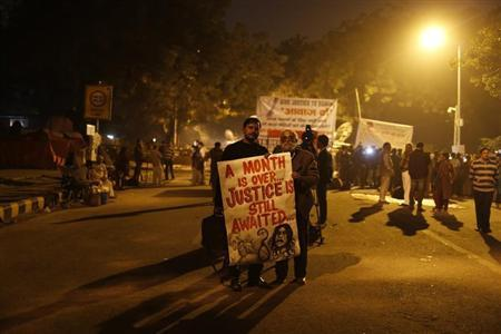 Demonstrators hold a banner during a candlelight march for a gang rape victim, who was assaulted in New Delhi January 16, 2013. REUTERS/Adnan Abidi