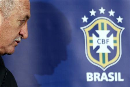 Brazilian national football team coach Luiz Felipe Scolari arrives for a news conference at Wembley stadium in London February 5, 2013. Brazil are set to play England in an international friendly football match on Wednesday. REUTERS/Stefan Wermuth