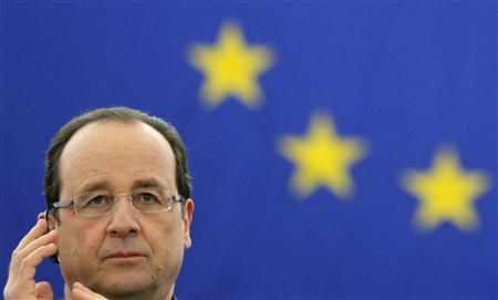 French President Francois Hollande adjusts his earphones as he attends European Parliament plenary session in Strasbourg, February 5, 2013. REUTERS/Christian Hartmann