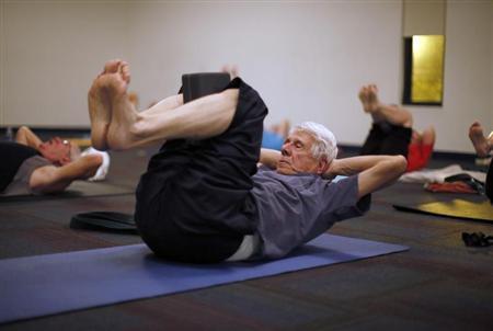 Retirees participate in a yoga class in Sun City, Arizona, January 7, 2013. REUTERS/Lucy Nicholson