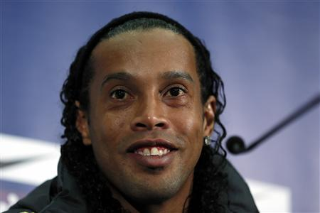 Brazilian national soccer team player Ronaldinho smiles during a news conference at Wembley stadium in London February 5, 2013. Brazil are set to play England in an international friendly soccer match on Wednesday. REUTERS/Stefan Wermuth